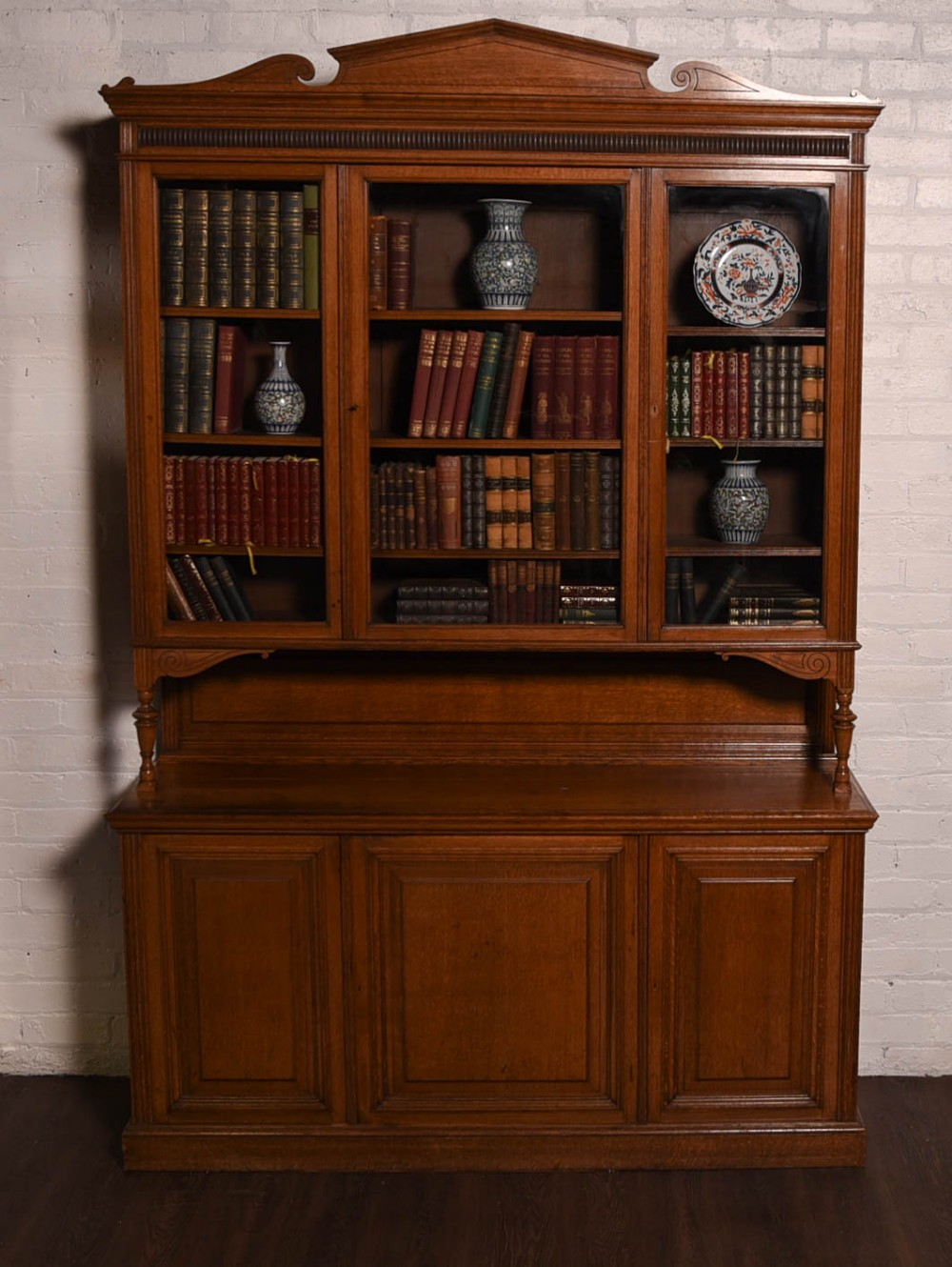 an impressive large oak 3 door oak library bookcase