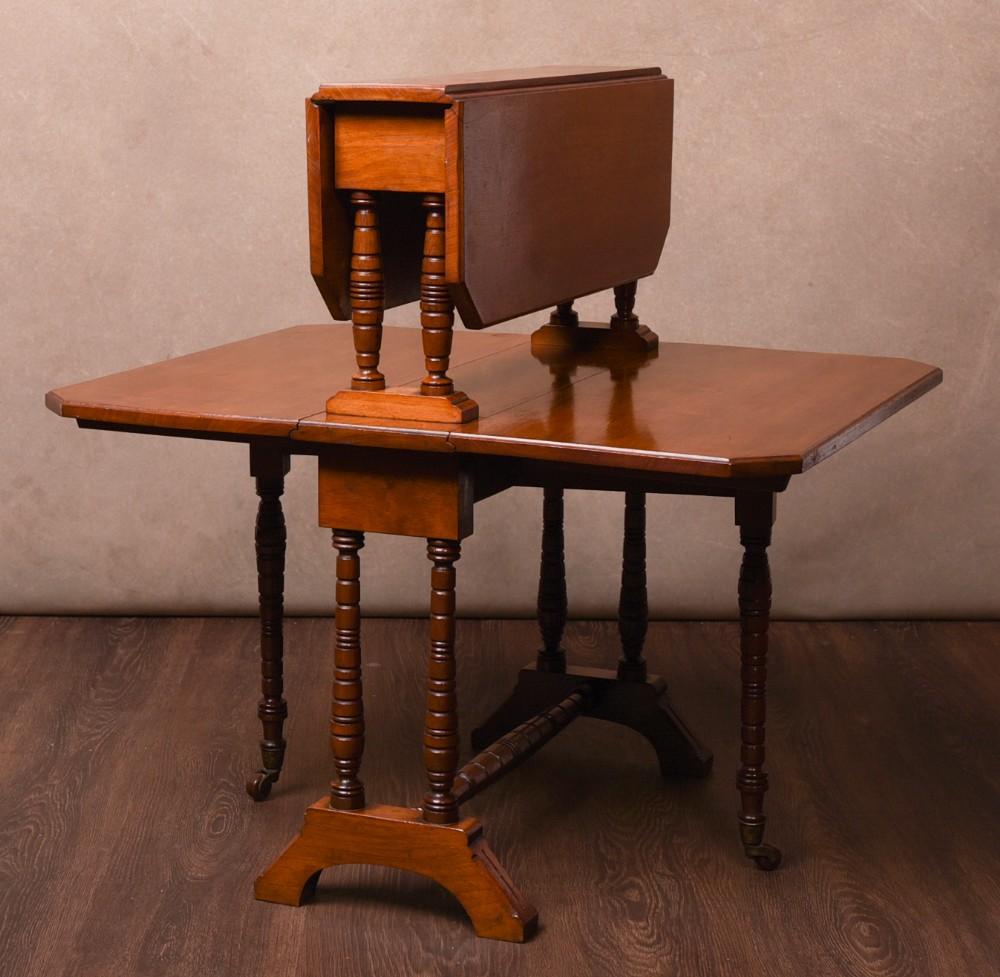 an unusual edwardian walnut double sutherland dropleaf table