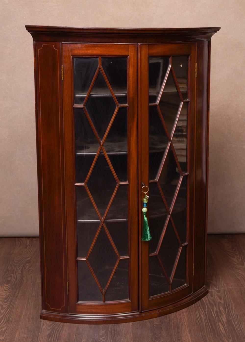 19th century inlaid mahogany bow fronted hanging corner cabinet
