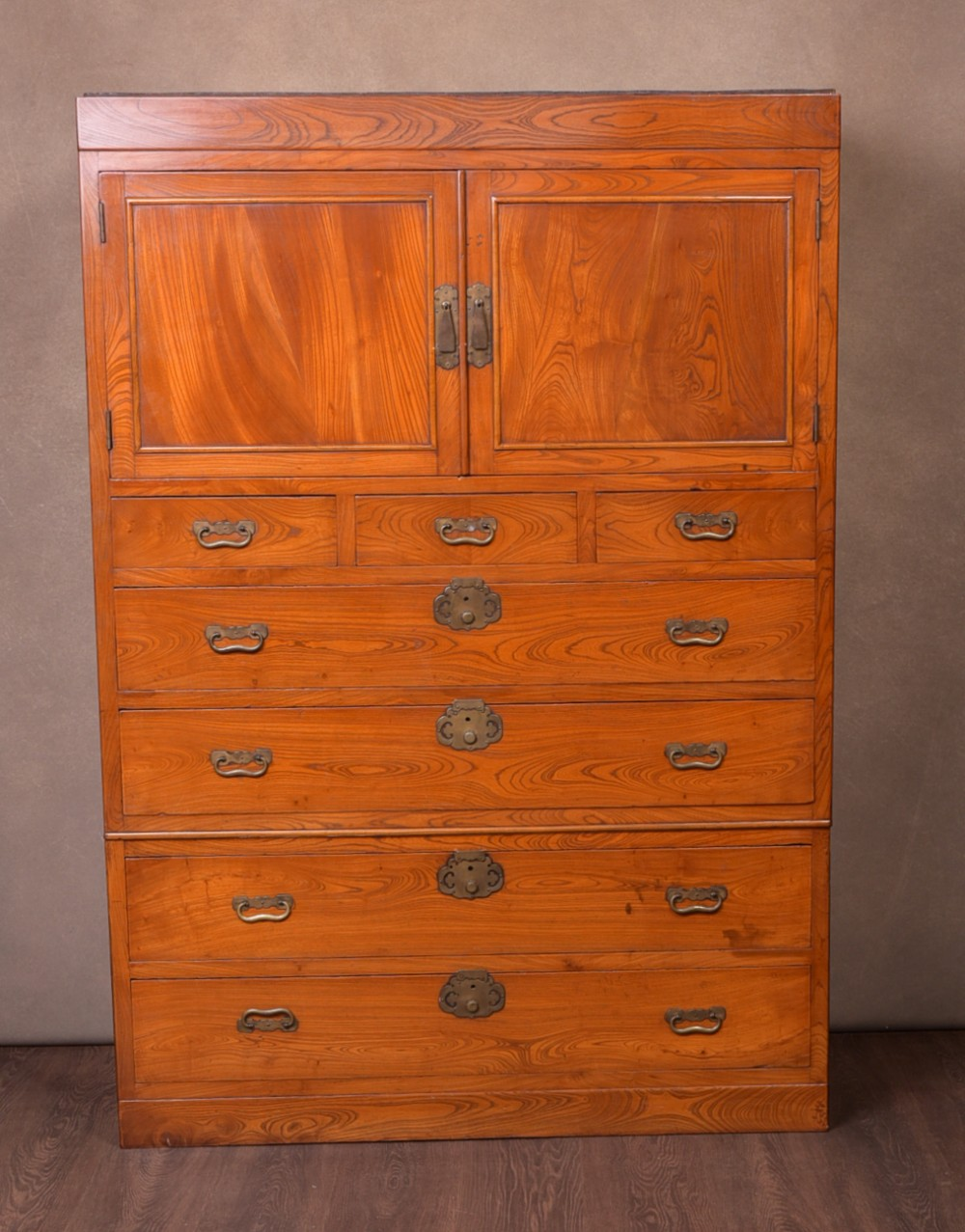 a fine oriental elm two section dansu chest