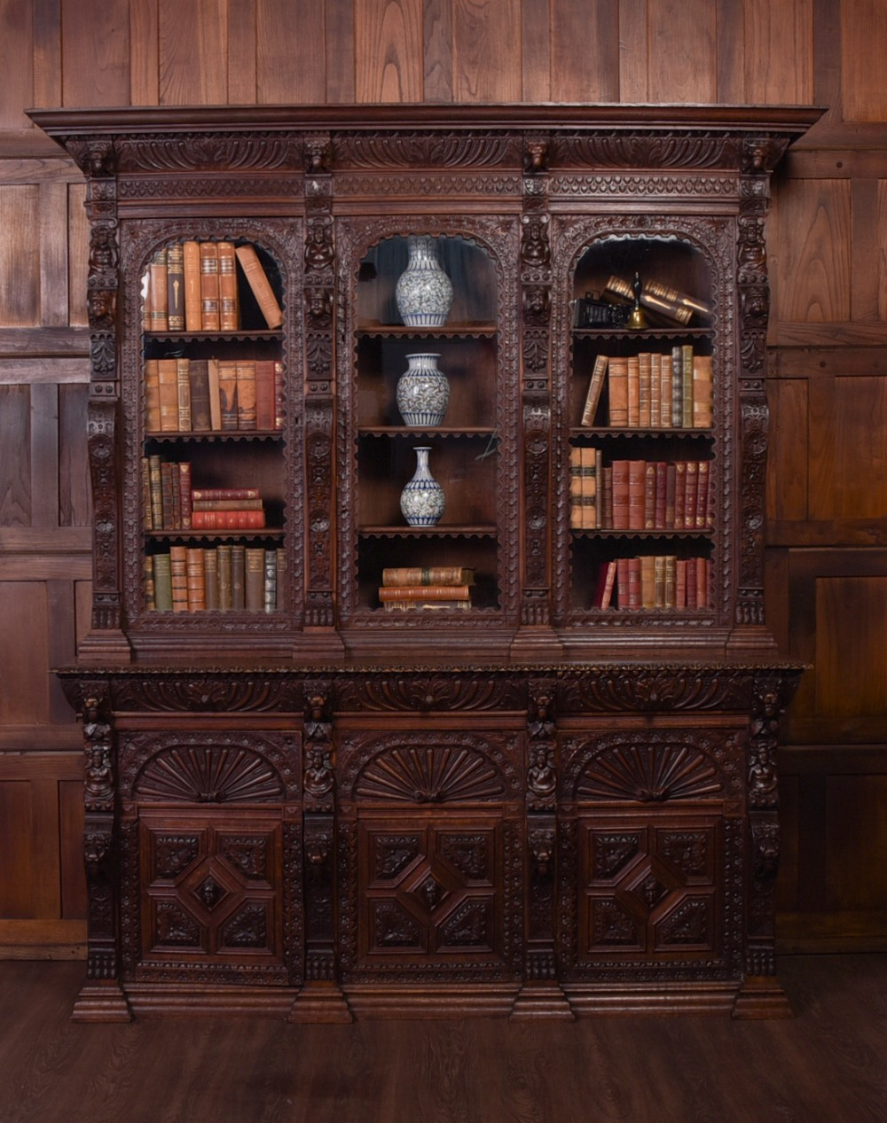 outstanding late 19th century carved oak 3 door bookcase