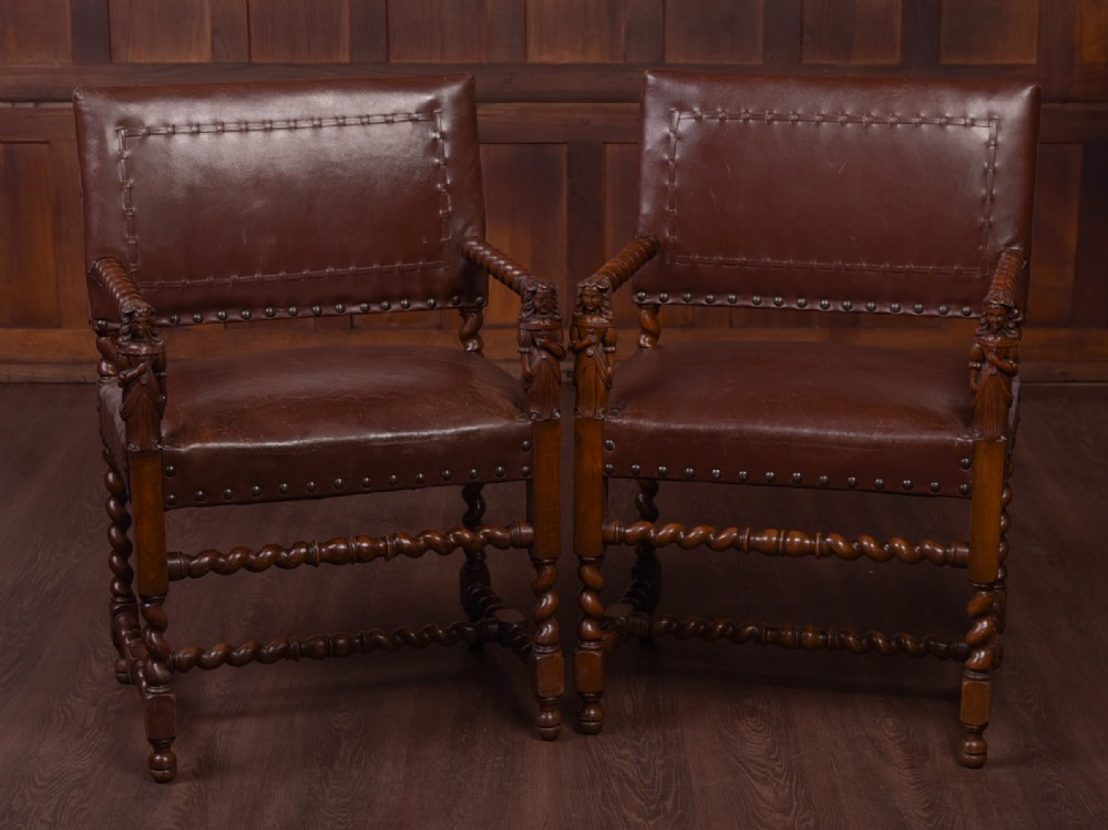 stunning pair of walnut arm chairs