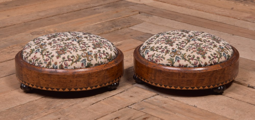pair of victorian inlaid walnut foot stools