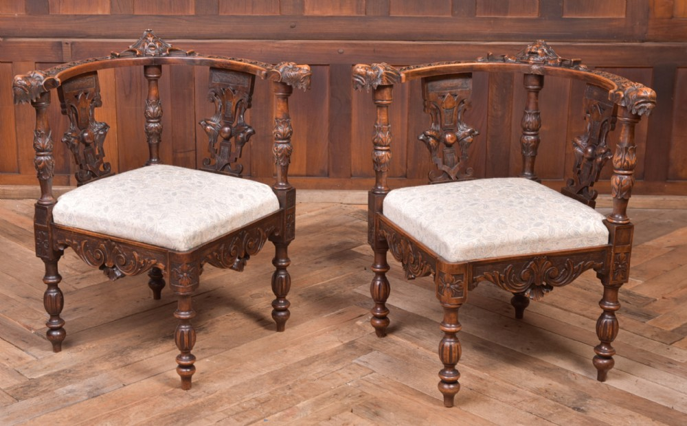 pair of 19th century carved walnut corner chairs