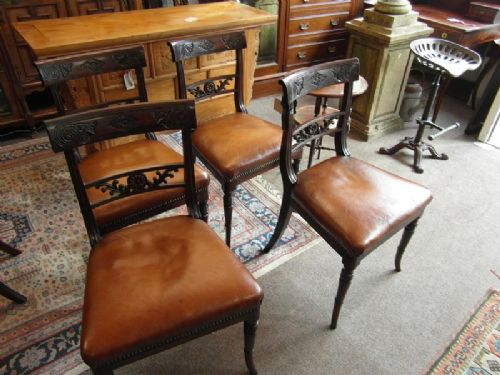 regency set of four rosewood dining chairs with leather seats