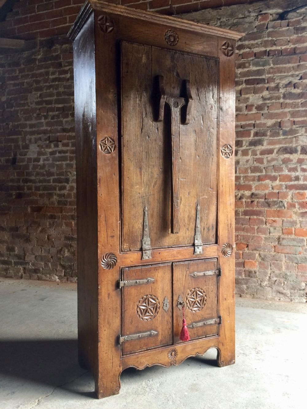 16th century dutch solid oak cupboard featuring a dropdown farmhouse table