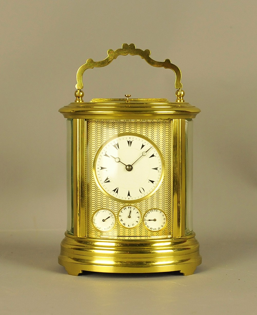 oval repeating carriage clock with calendar and alarm