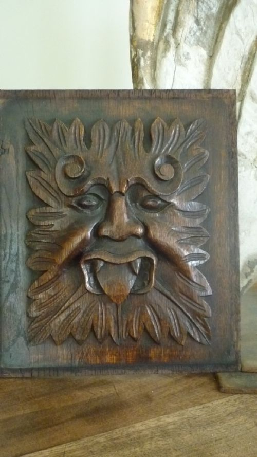 Th century carved oak panel green man