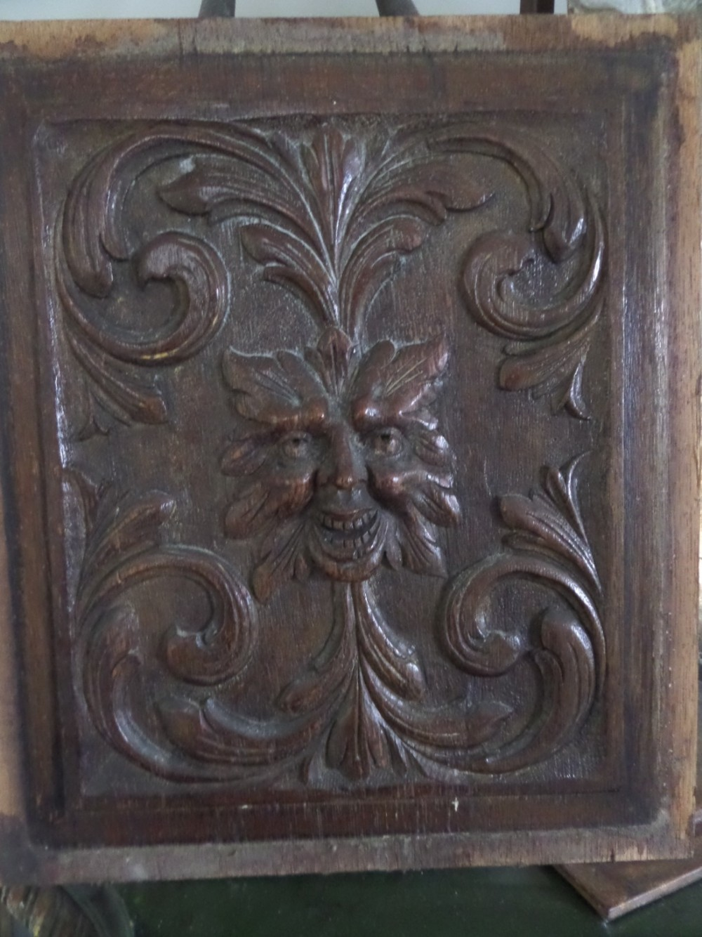 Large victorian carved oak mask face panel green man