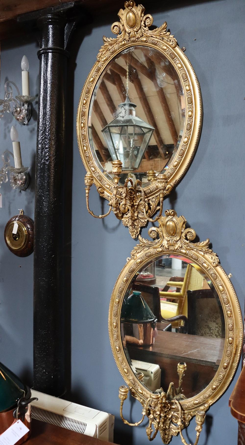 pair of oval gilt mirrors