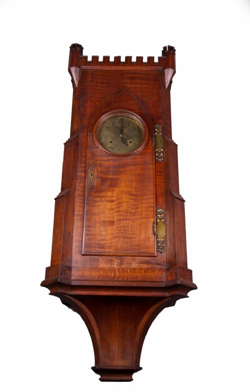 arts and crafts oak bracket clock with brass dial with castellated turrets