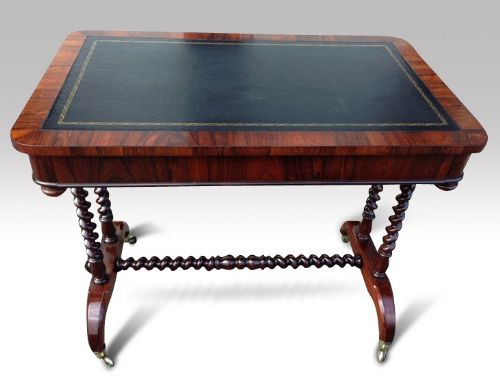 an early victorian rosewood writing table