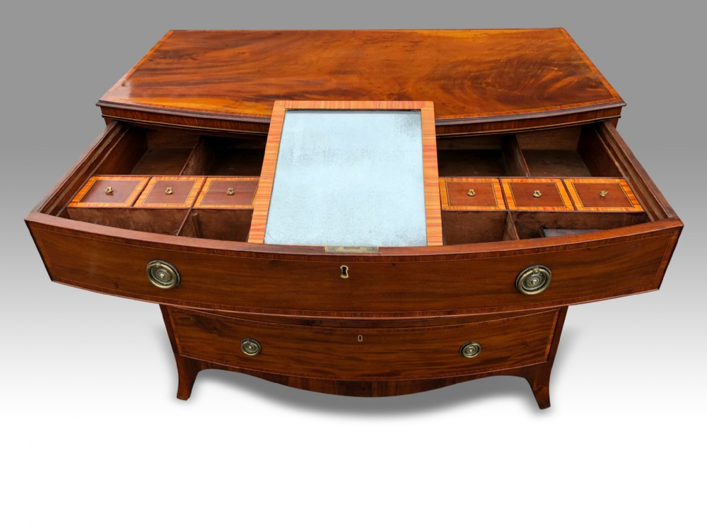 a superb george iii mahohany tulipwood banded bowfront dressing chest