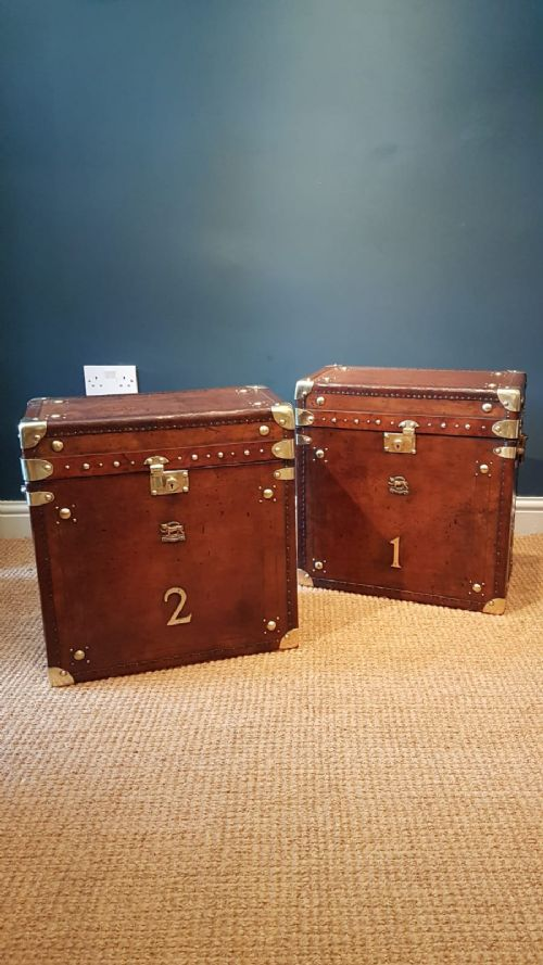 pair of antique leather bound military trunks