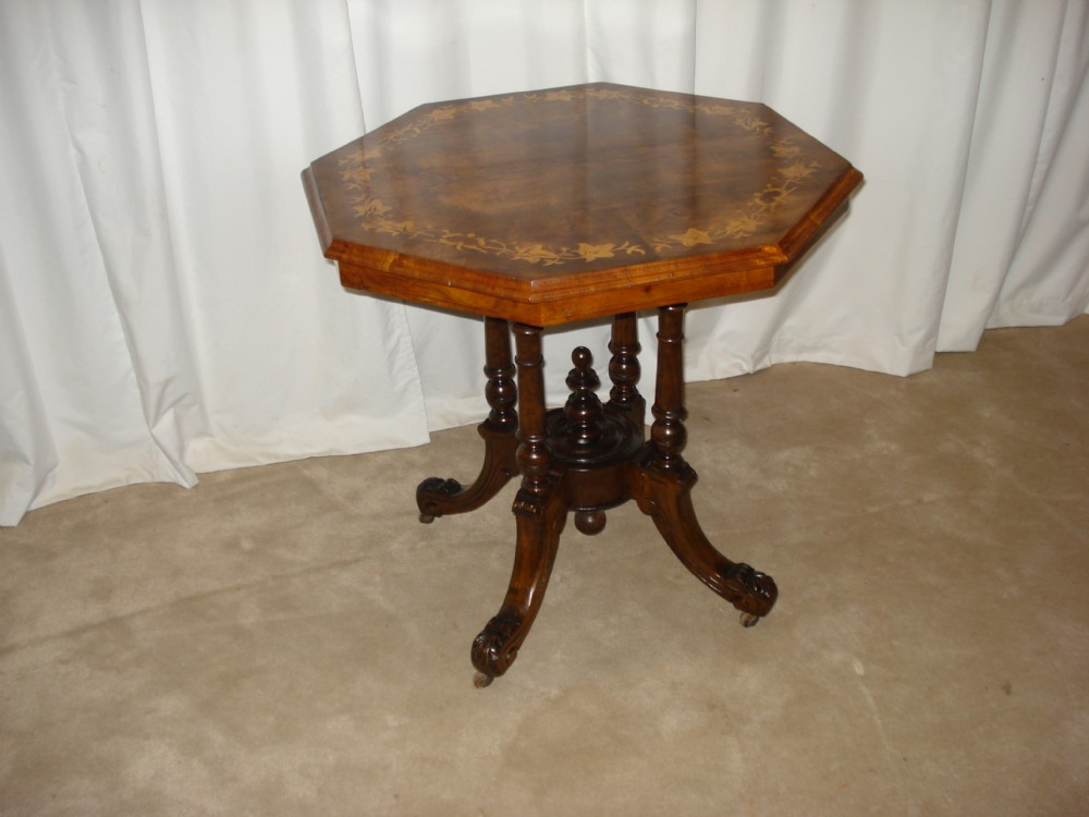 a victorian walnut octaganal table