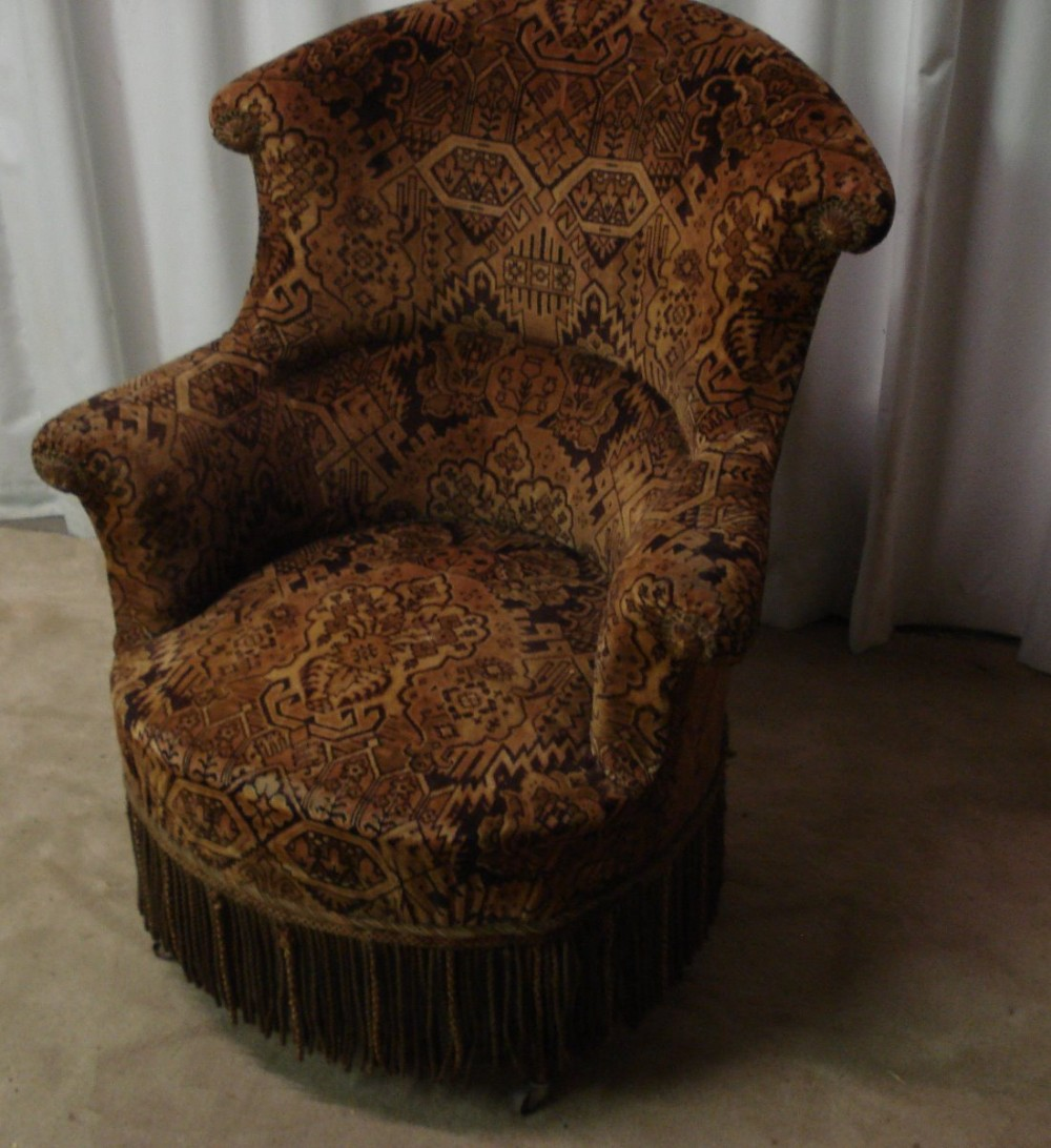 a 19th century high back armchair