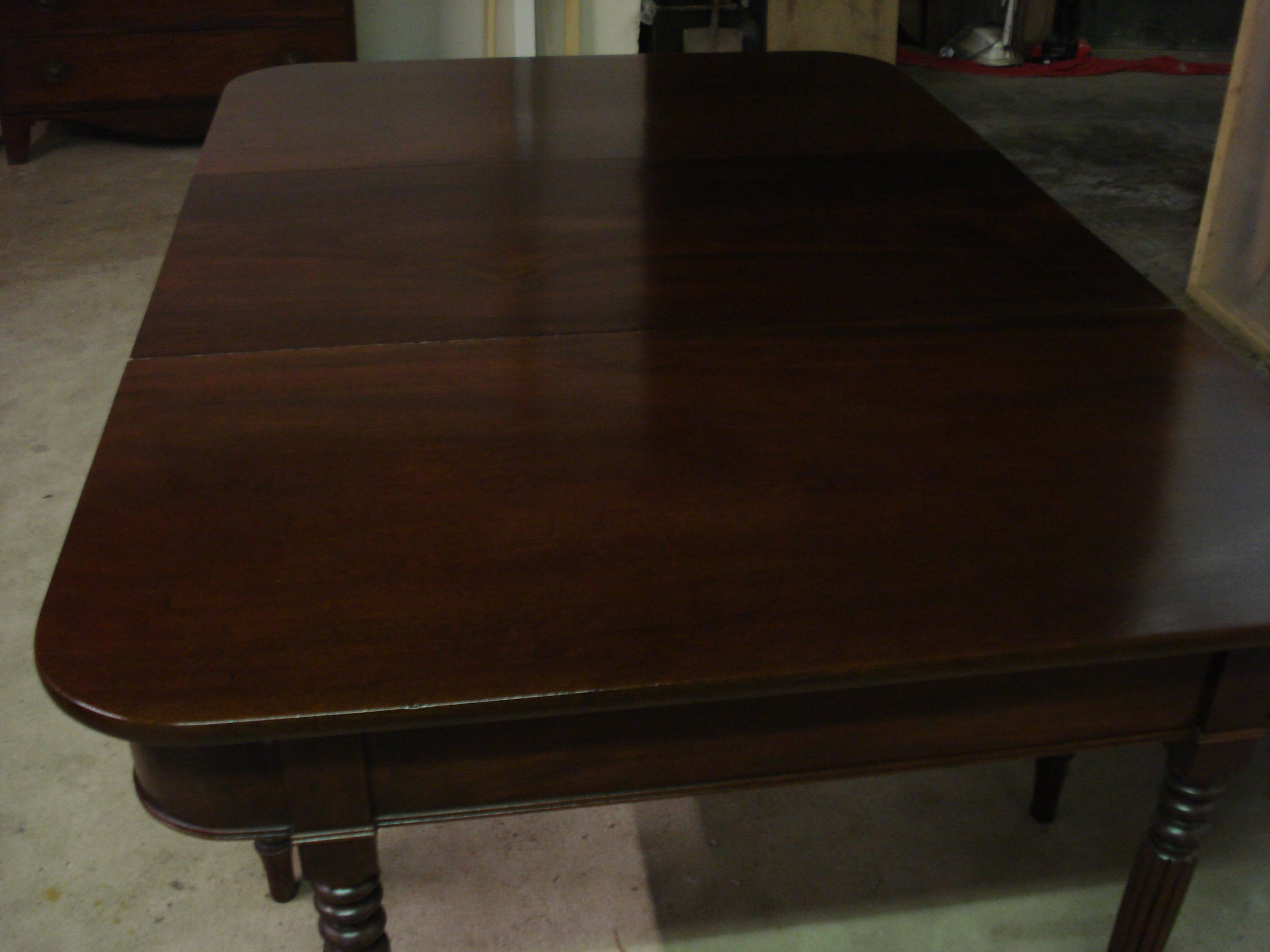 a 19th century mahogany d end table with one leaf