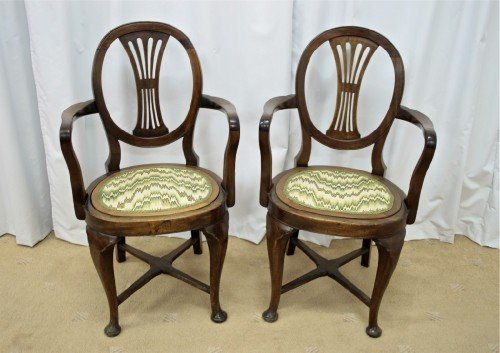 two edwardian walnut beechwood open armchairs