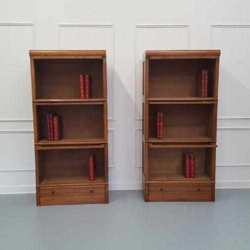 pair of paris made oak stacking bookcases haberdashery c1930