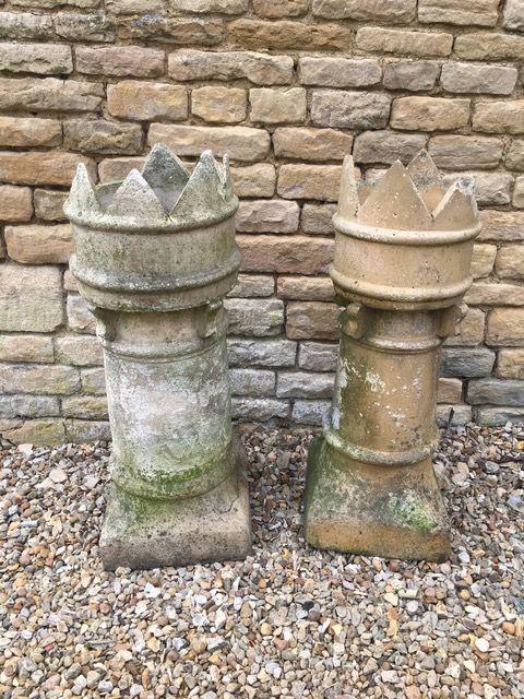 near pair of stone chimney pots