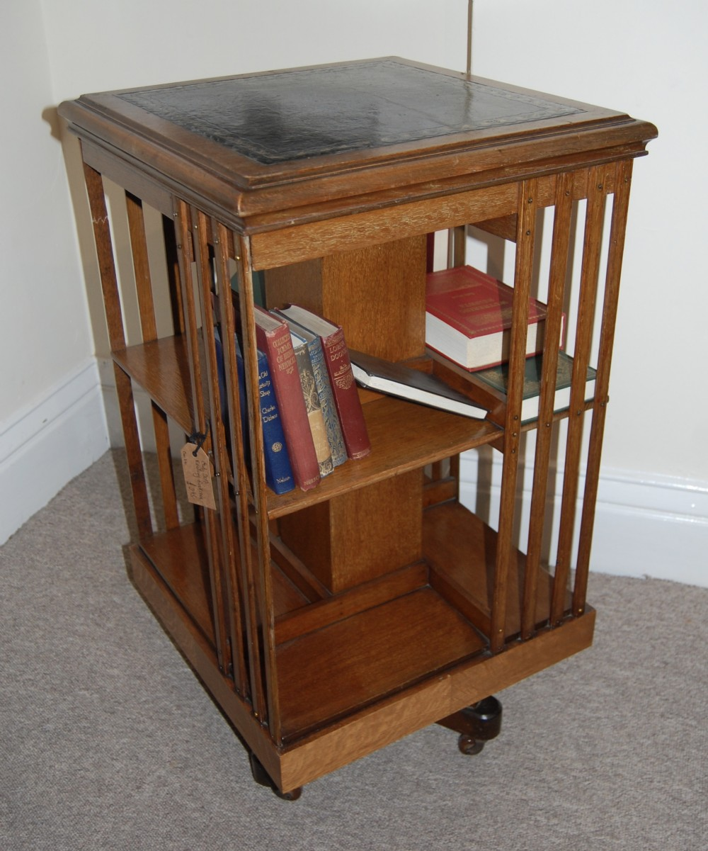 revolving bookcase on cruciform base