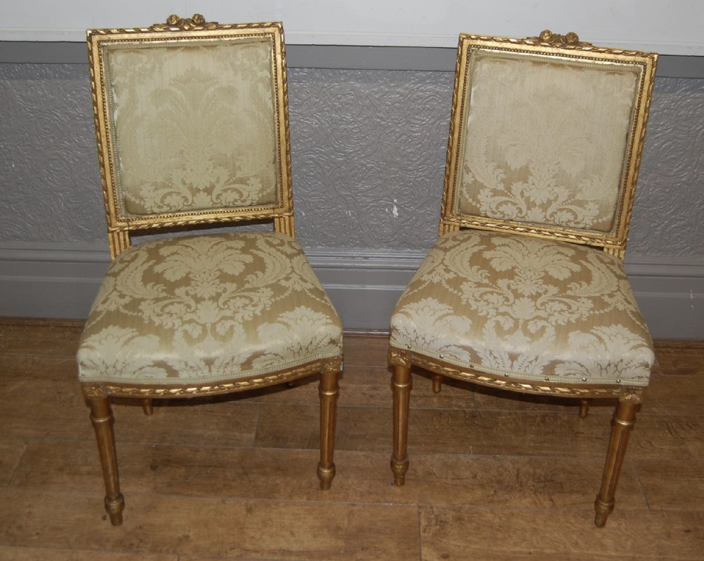pair of french gilt side chairs