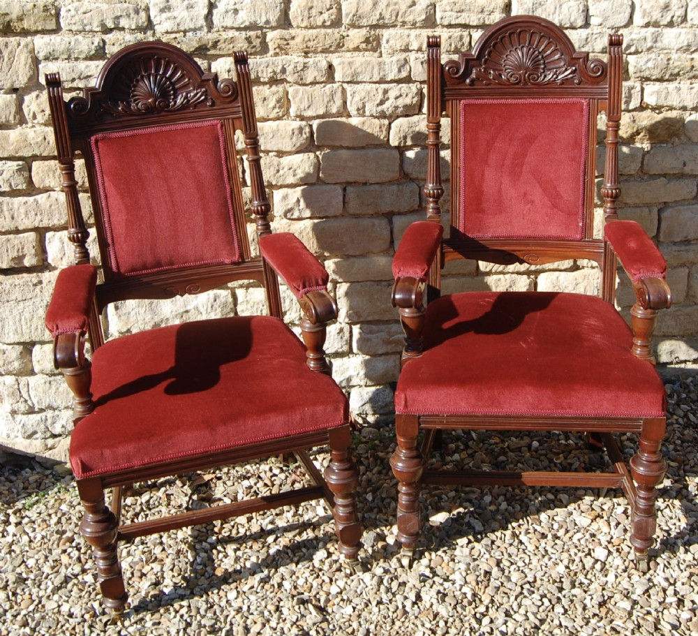 pair of red upholstered carver chairs