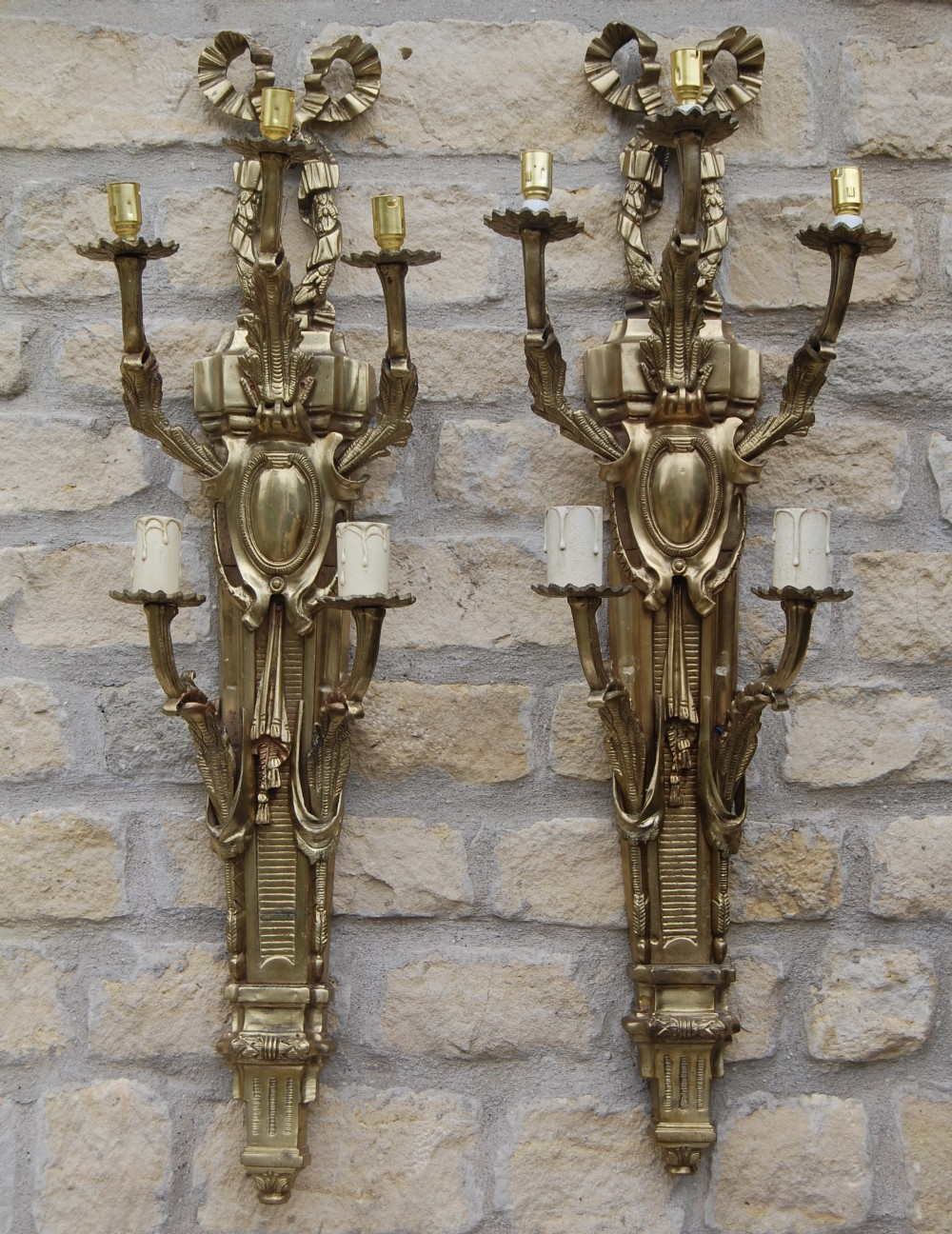 very large pair of ornate brass wall lights