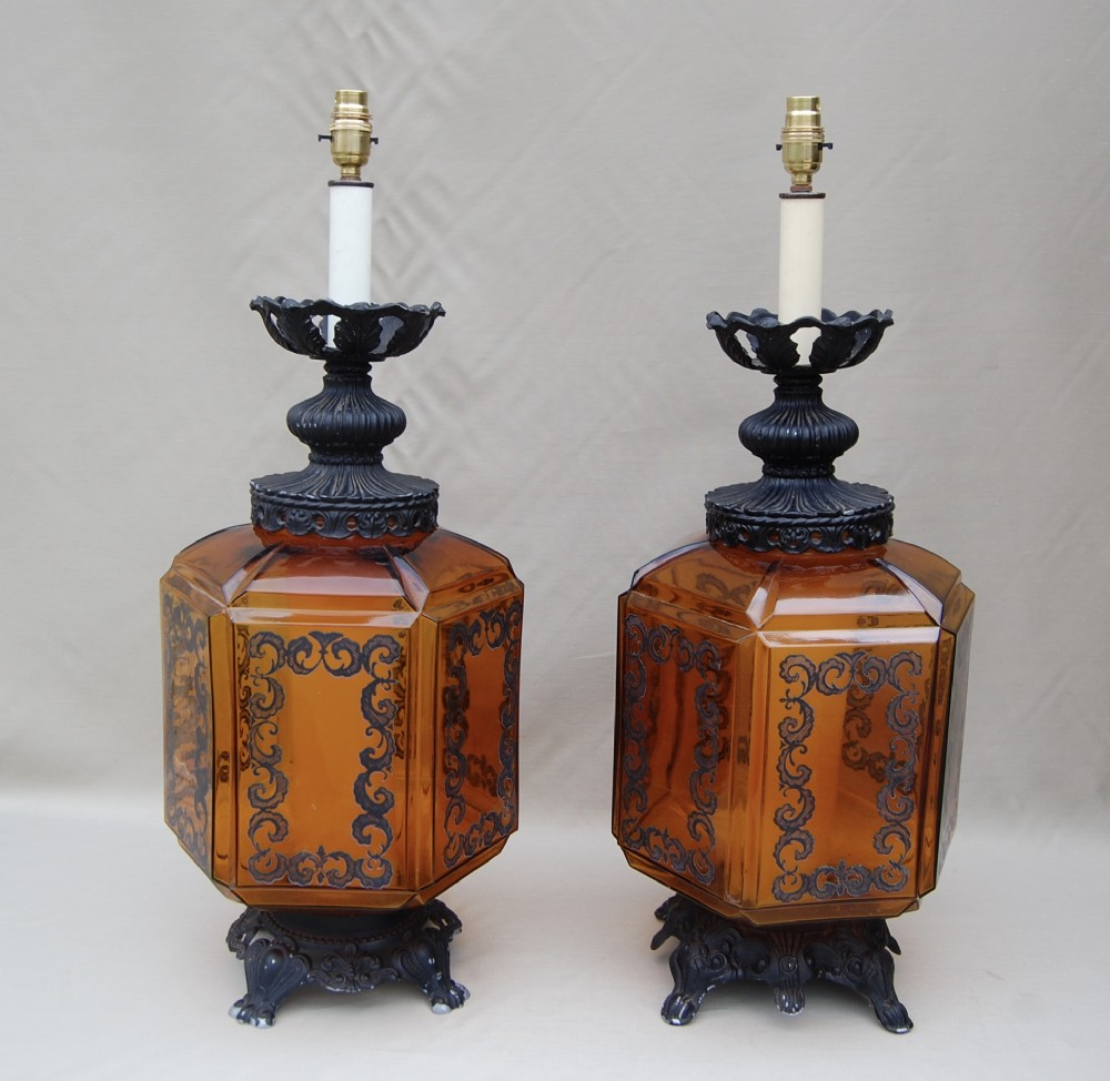 unusual pair of vintage glass lamps with cast iron necks and bases
