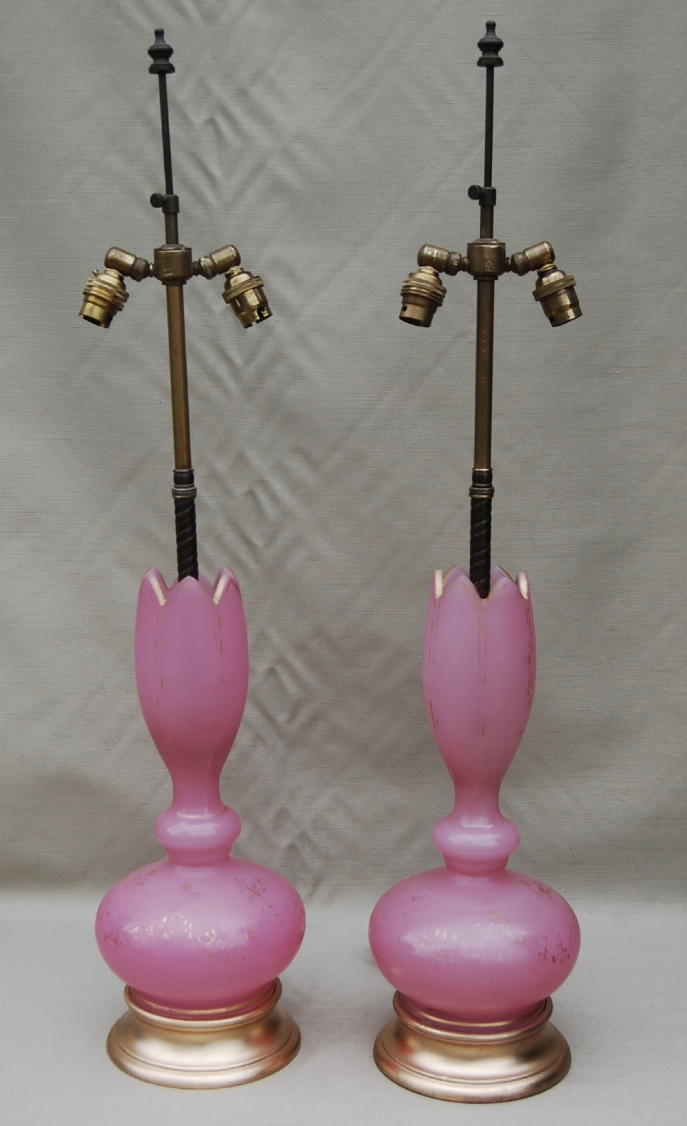 pair of opaline glass lamps with tall brass twinlamp fittings