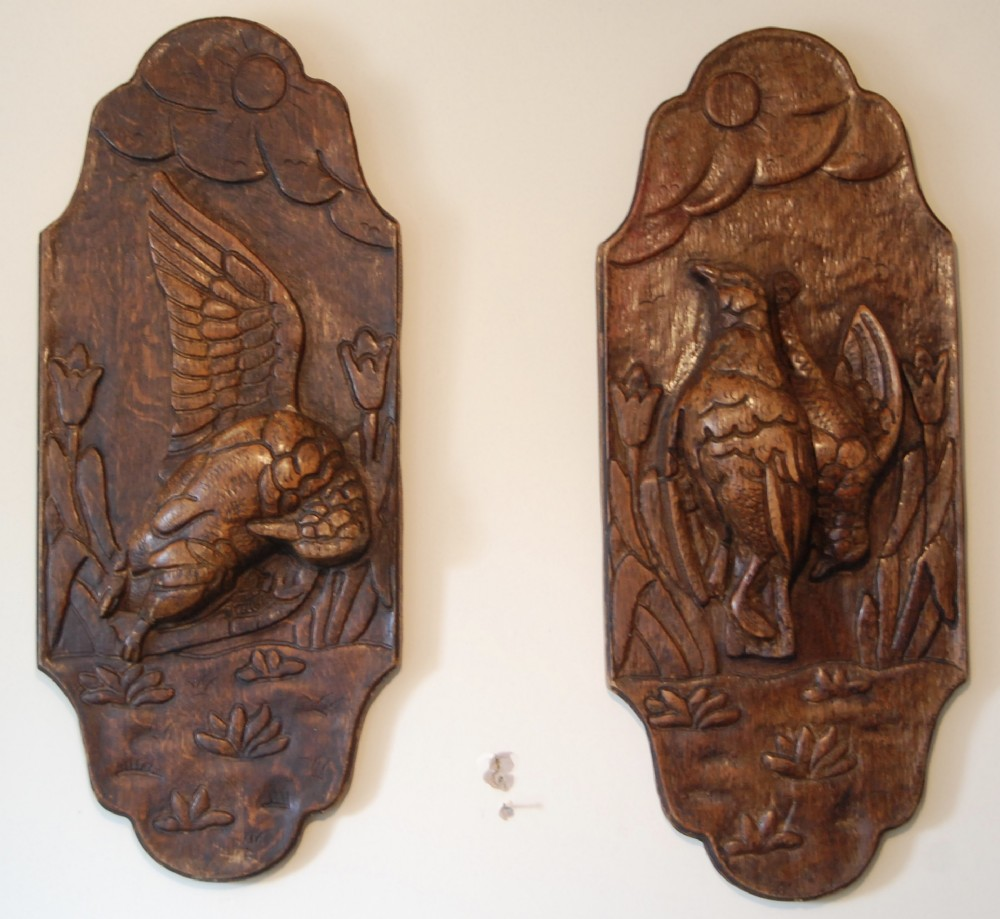pair of oak carved plaques depicting game birds