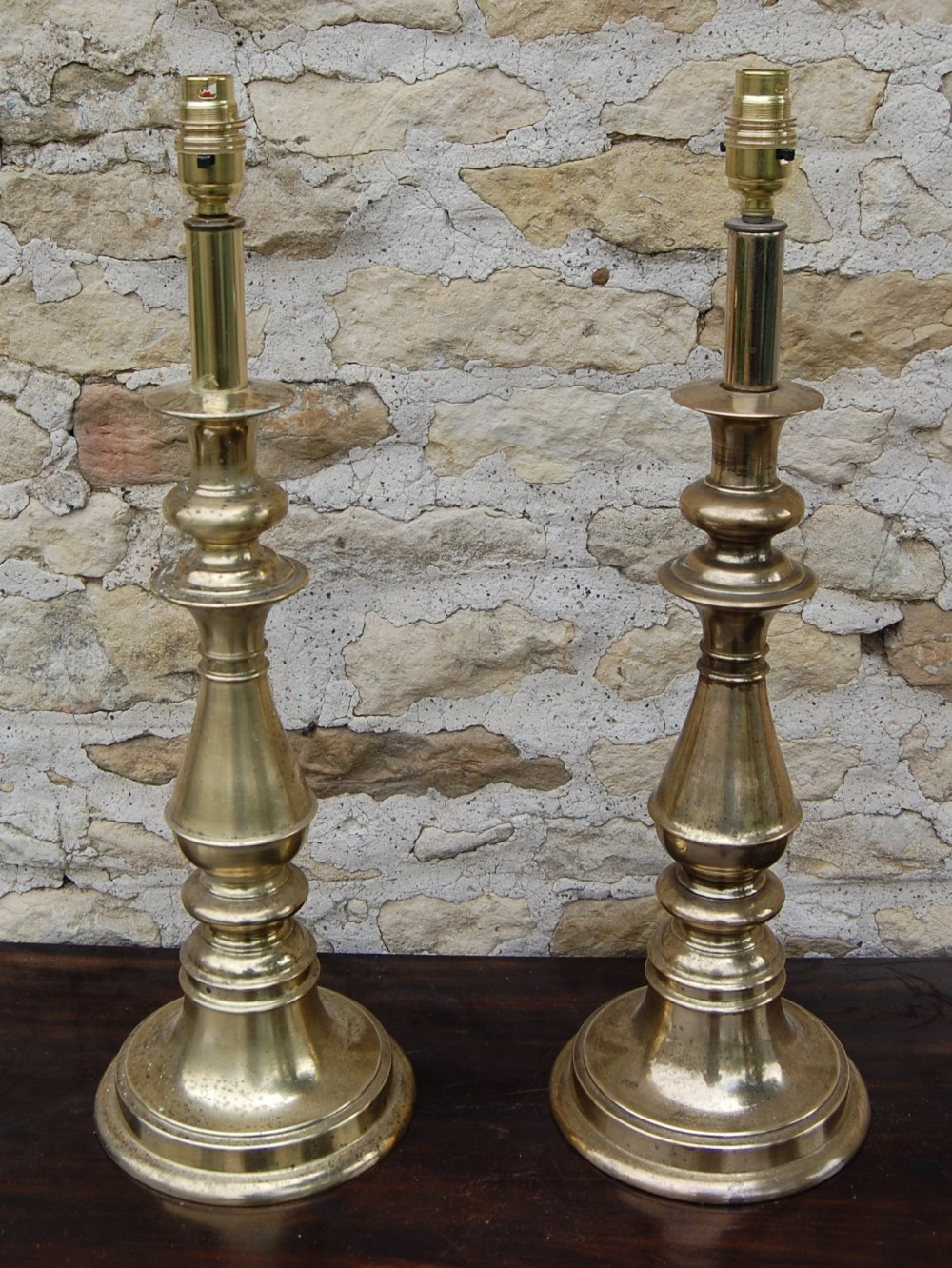 reduced pair of original brass lamps