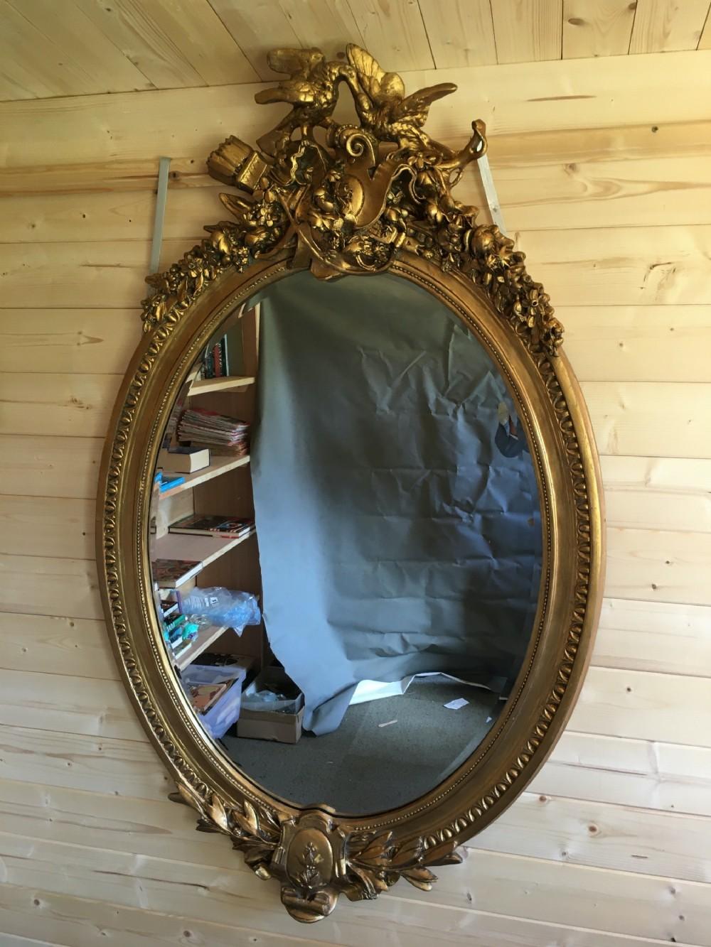 large impressive oval gilt mirror