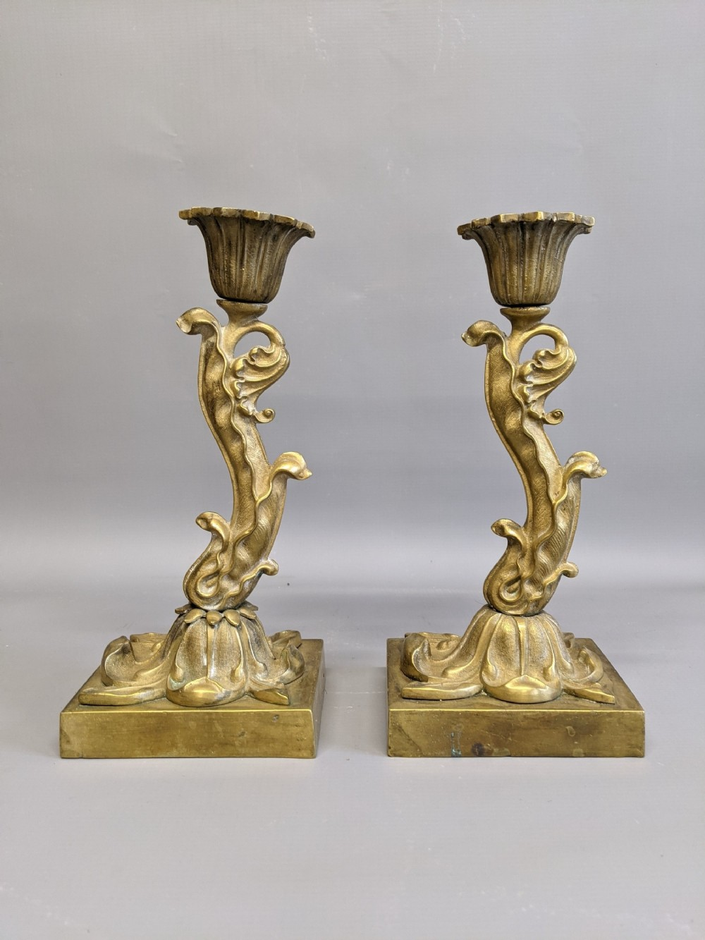 unusual pair of brass candlesticks