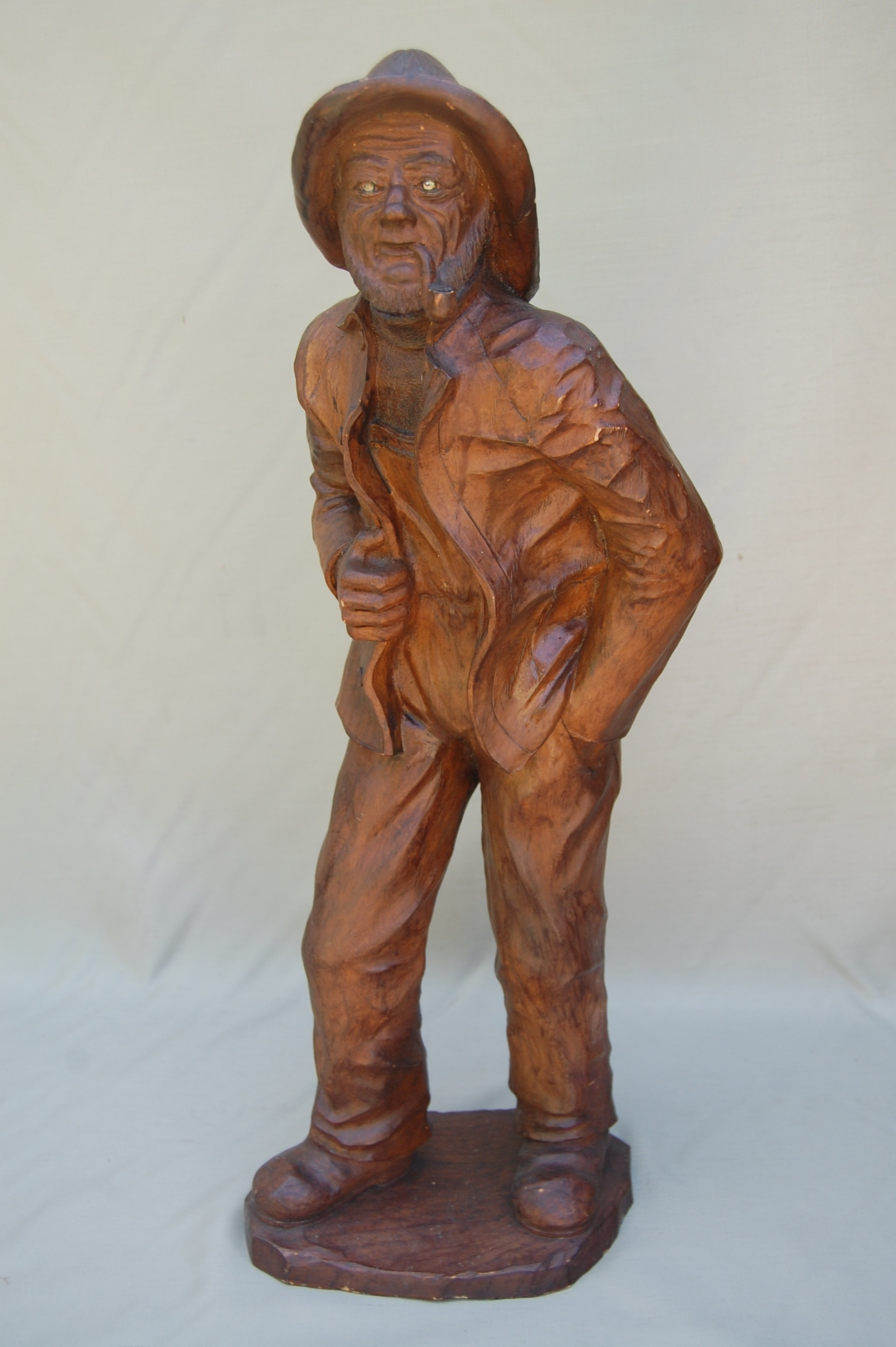 hand carved statue of breton fisherman