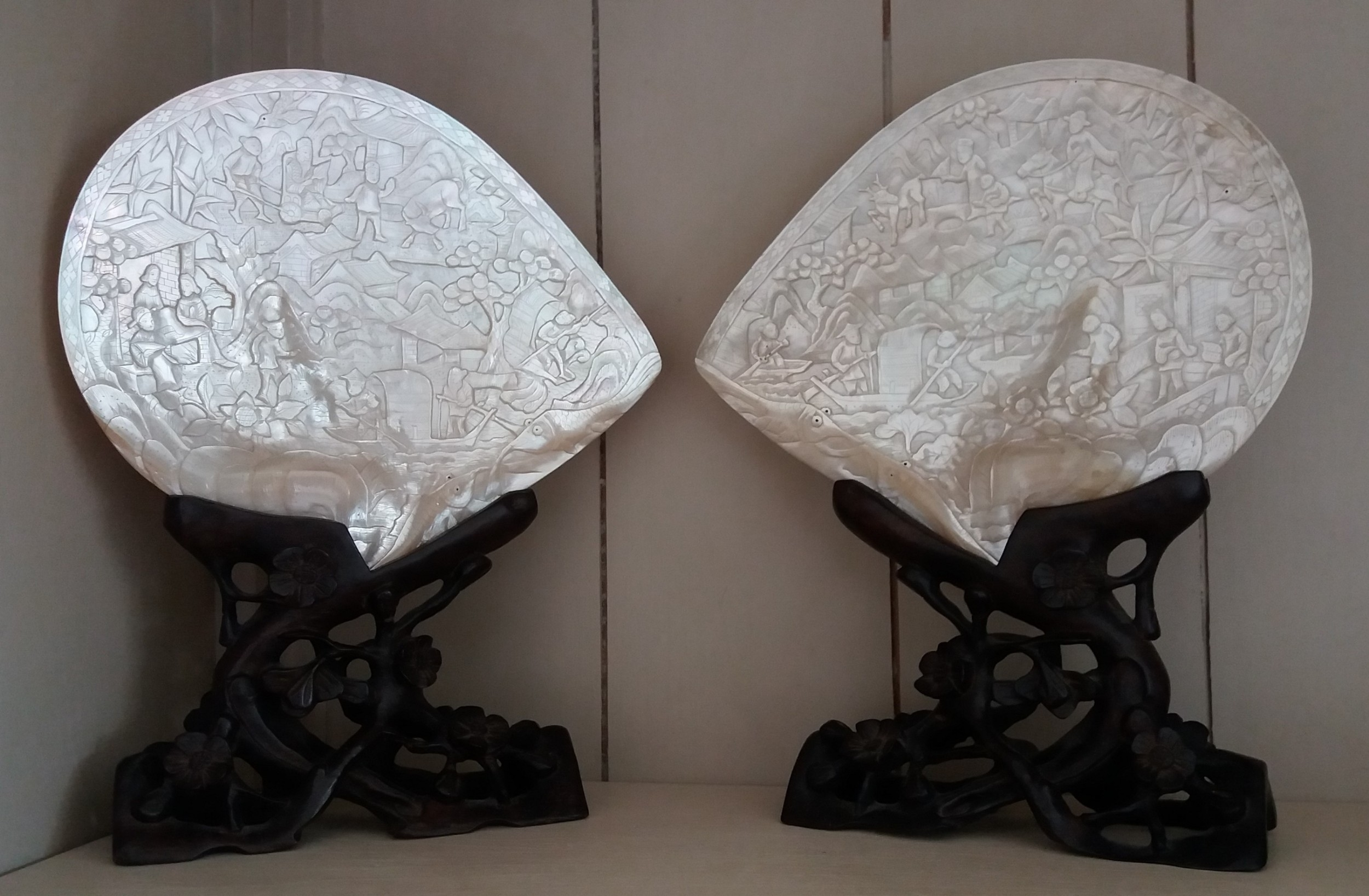 pair of chinese carved shells on carved stands