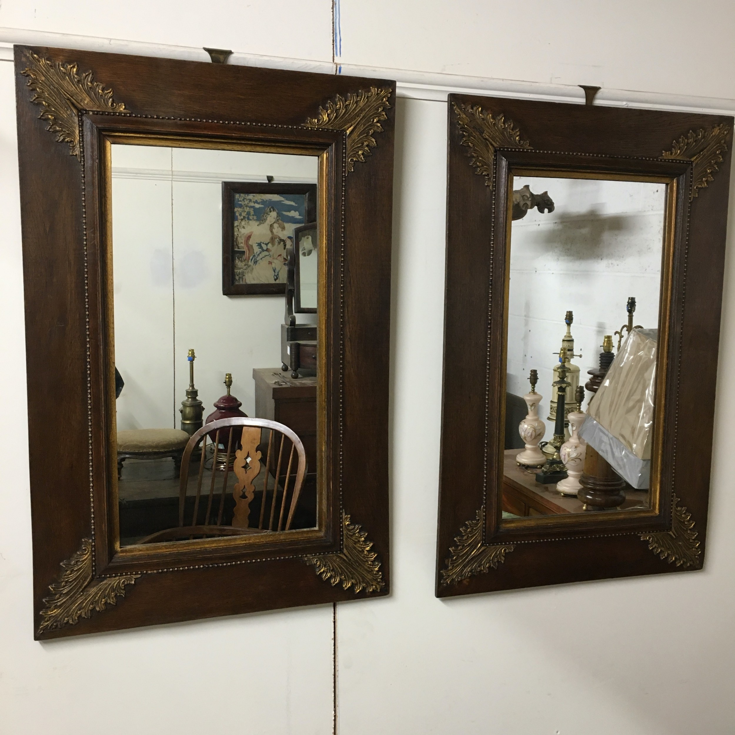 pair of late 19th century early 20th century oak mirrors