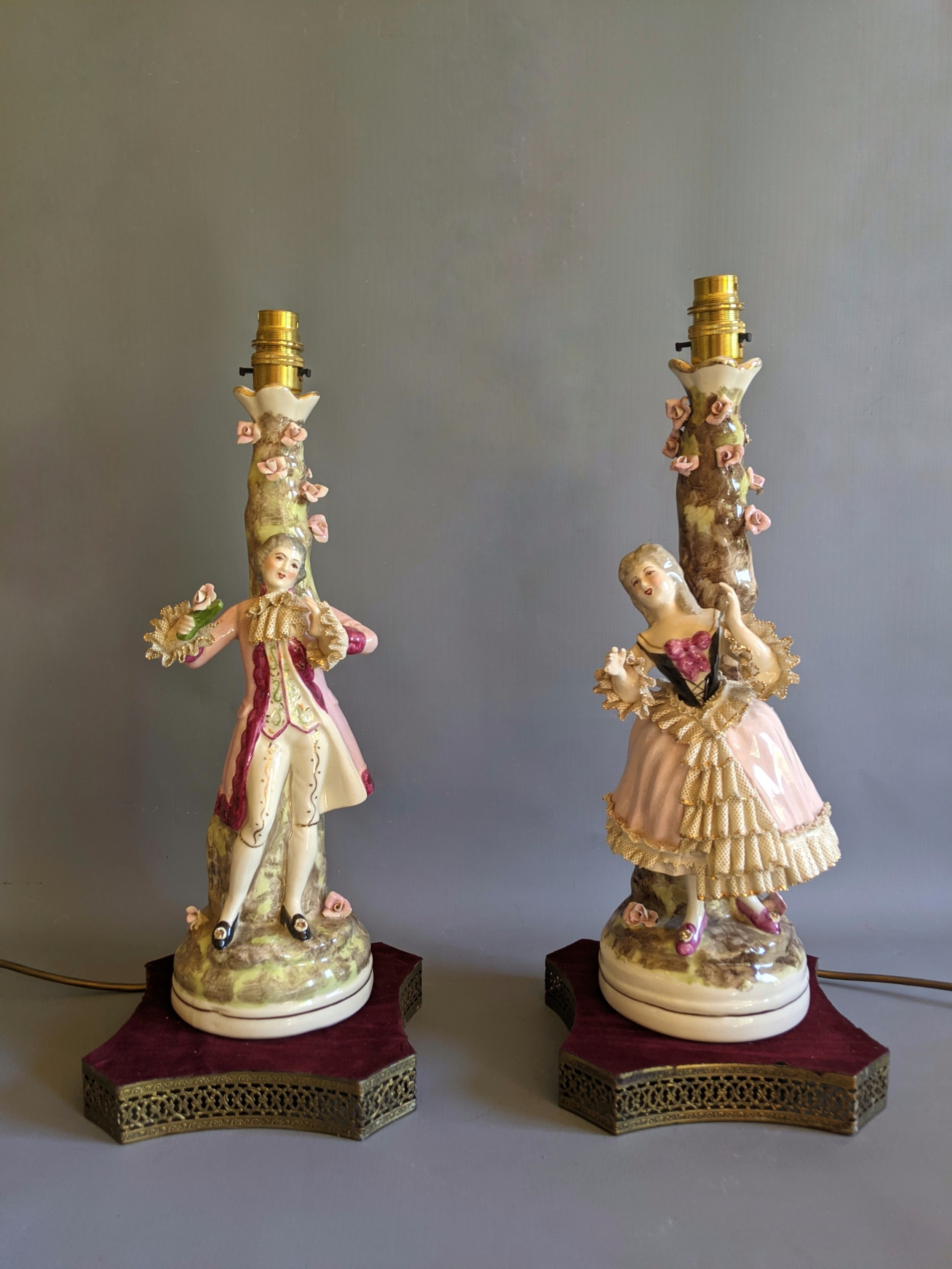 pair of early 20th century china figurine table lamps