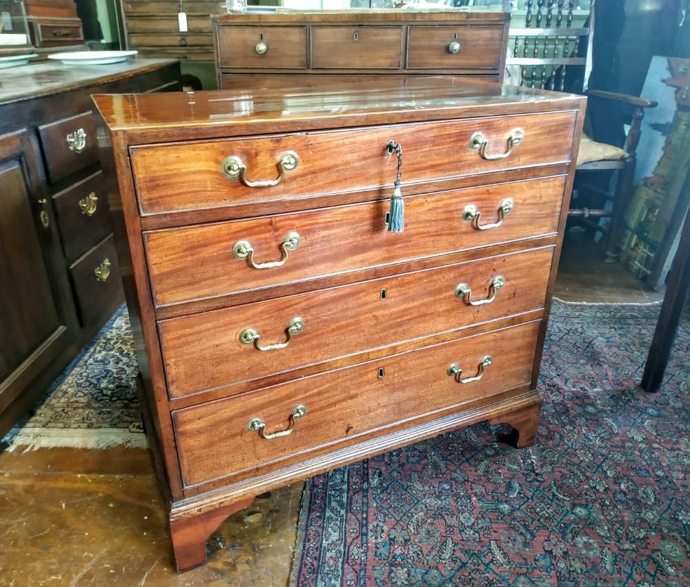 petite 18th century mahogany chest of drawers with bracket feet