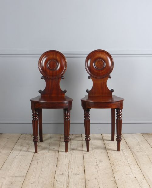 pair of late regency mahogany hall chairs