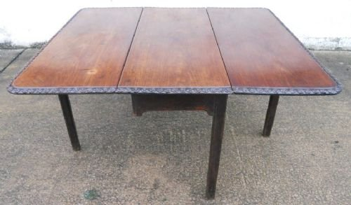 georgian mahogany dropleaf dining table with carved border