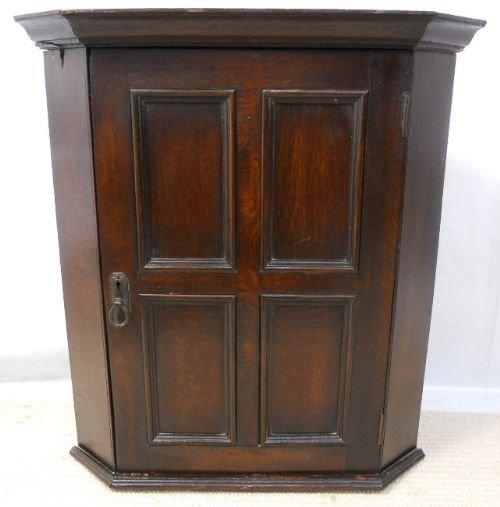 small dark oak panelled hanging corner cupboard