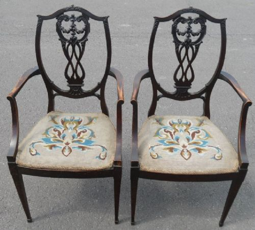 pair edwardian carved mahogany salon armchairs