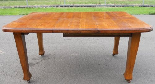edwardian golden oak dining table to seat six