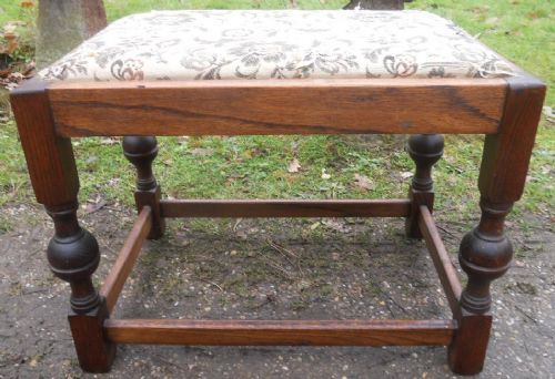 large heavy oak upholstered stool