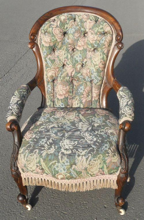 victorian mahogany framed upholstered fireside armchair