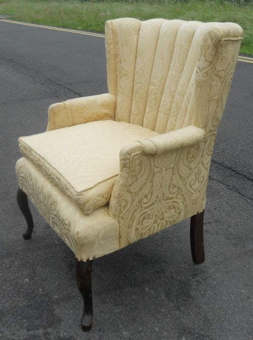 wing low back upholstered armchair