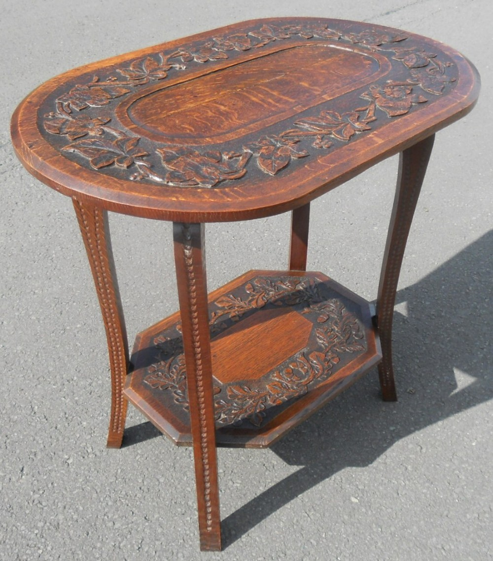 edwardian carved oak oval two tier occasional table