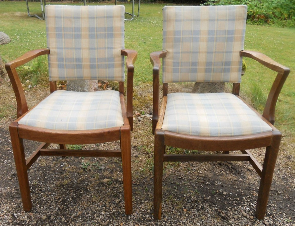 pair oak framed upholstered library armchairs