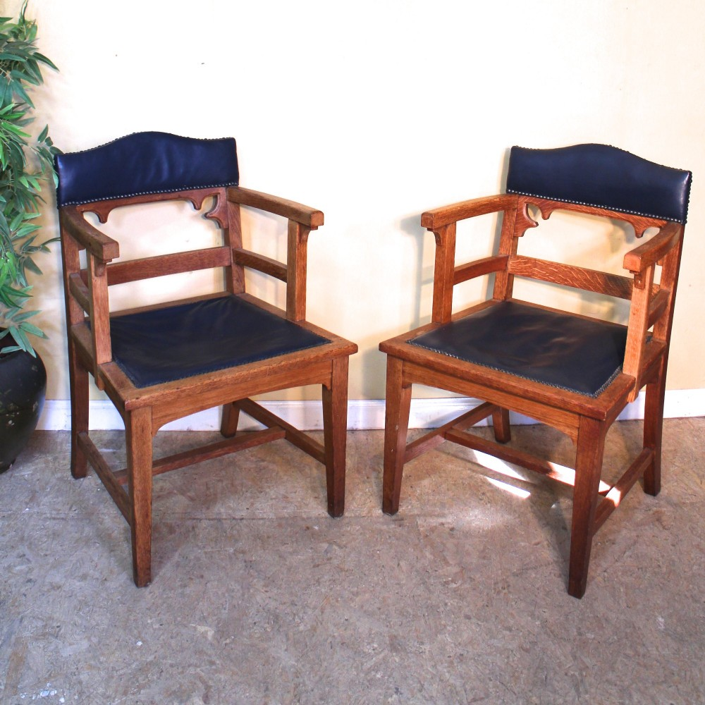 pair of gothic arts crafts oak desk chairs